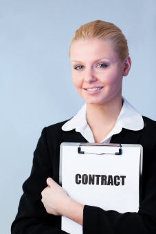 Woman holding a contract on a clipboard