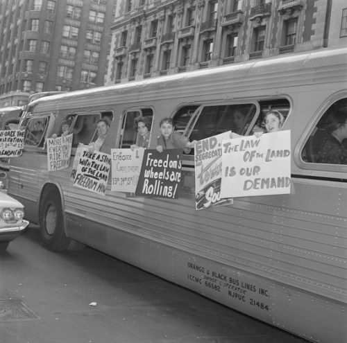 """30 May 1961, Times Square, Manhattan, New York, New York, USA --- Freedom Group Hangs Signs on Bus. New York: Members of a group called """"The Washington Freedom Riders Committee"""" hang signs on the side of bus parked near the crossroads cafe at Times Square here May 30th, before leaving for Washington, D.C. The group plan to picket the white House in Washington. A spokesman for the group said it is demanding resolute federal action to protect the lives and civil rights of the Negroes in the south. The unidentified spokesman said they would request to see a representative of President Kennedy to present its demands. --- Image by © Bettmann/CORBIS"""